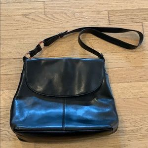 Medallion black leather shoulder bag